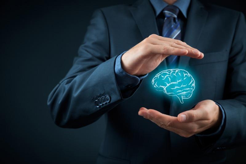 Man holding a brain image